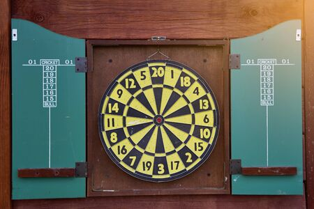 Darts game. round dartboard. Dart arrow hitting in the target center of the dartboard. Marketing concept.