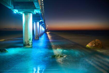 Long exposure pier on the Baltic Sea at night. Zelenogradsk city, Kaliningrad region.