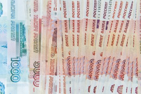 Money on Russia. Close-up of Russian rubles on five thousand and one thousand banknotes. Finance concept. 写真素材