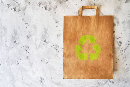 blank eco brown paper bag on light background. Mock up 写真素材
