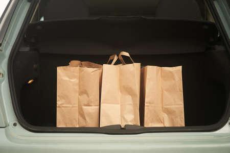 Blank paper bags in a car trunk 写真素材