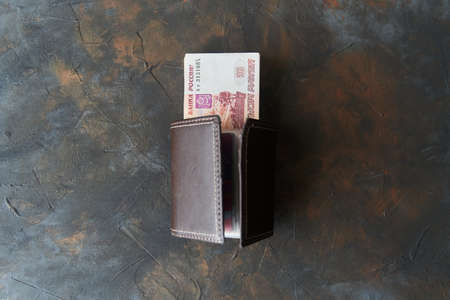Russian rubles. Five thousandth notes stick out of the wallet. 写真素材