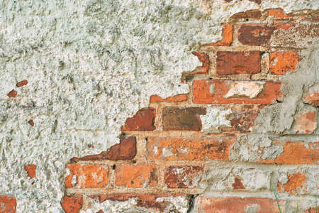 Old red brick wall with concrete. Texture