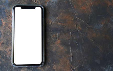 A black smartphone on a dark background.