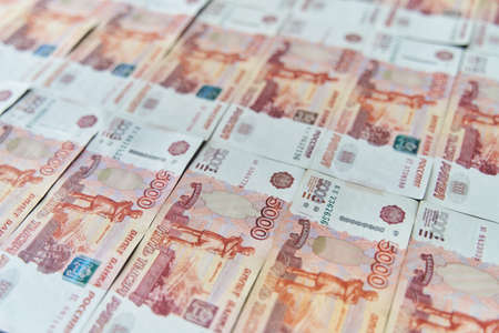 Money on Russia. Close-up of Russian rubles on five thousand and one thousand banknotes. Finance concept. Фото со стока