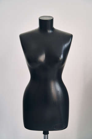 Black female mannequin for clothing on white background