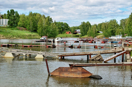 hand rails: Motor boats and vessels on the dock in the summer