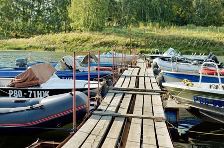 hand rails: Mooring for motor boats on the Bay in the summer Editorial