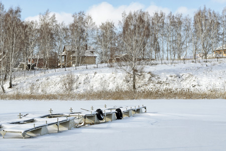 frozen river: Mooring for motor boats on a frozen river