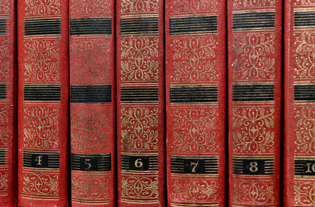 numbering: The old pile of red books on the shelf - works