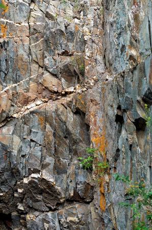 valuable: A cliff with a valuable mineral rocks Stock Photo