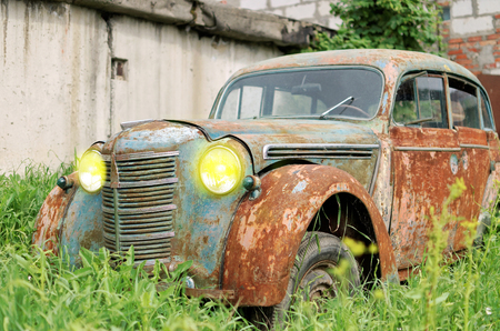 rusty car: An old rusty car with an open window in the Parking lot Stock Photo