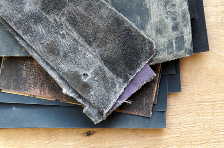 sandpaper: A set of sandpaper for wood and metal against the sheet of plywood Stock Photo