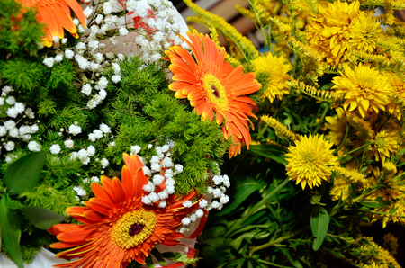 mixed marriage: A bouquet of red and yellow flowers - wedding ceremony Stock Photo
