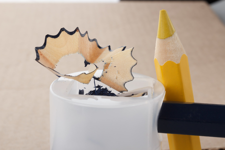 sharpening process: two pencils and a pencil sharpener in the process of sharpening Stock Photo