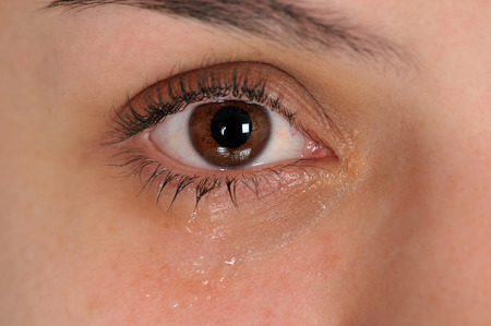 crying eyes: Close up of eye with tears Stock Photo