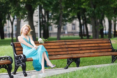 summer dress: blond sexy girl on bench summer dress