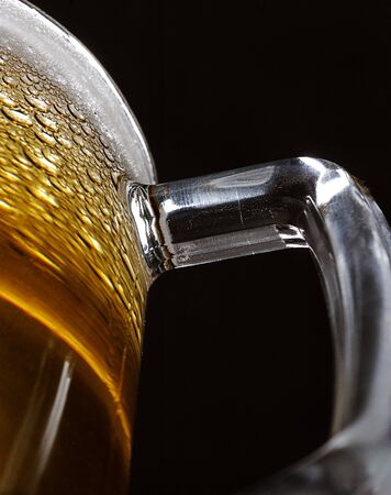 close uo: close uo of handle beer glass  on black background Stock Photo