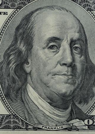 ben franklin money: close up of Franklin on 100 dollars bill