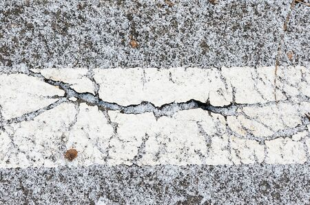 pot hole: Crack on asphalt under snow in winter Stock Photo