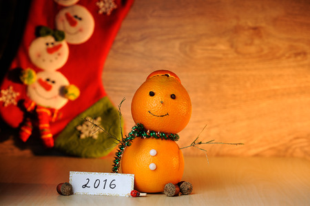 snowman wood: smile Snowman from orange decoration on wood table