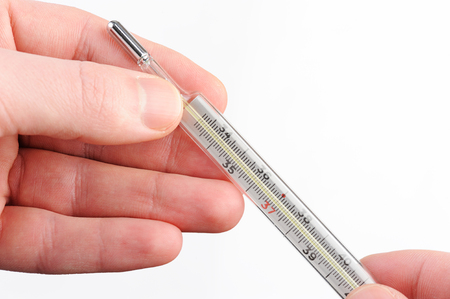 glass thermometer: glass thermometer in hand on white background