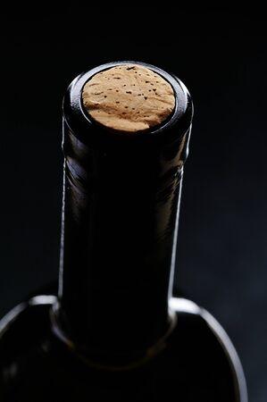 closed corks: macro of cork wine bottle on black background
