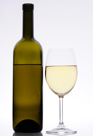 isoleted: white wine bottle and glass isoleted in background