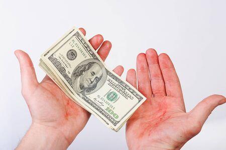 Blood hand hold money dollar on white Фото со стока