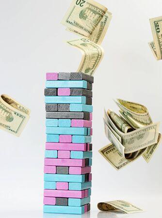 money flying: jenga game with dollar money flying Stock Photo