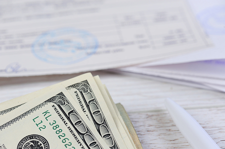 unpaid: pay money bills with dolars on wood table