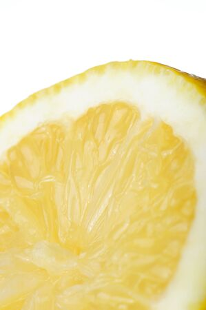 macro close up: lemon slice skin macro close up on white background