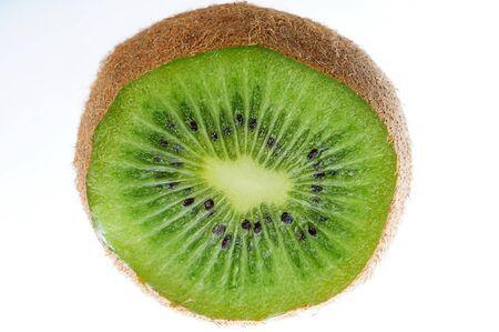 sweet segments: kiwi half slice vivid fresh on white background