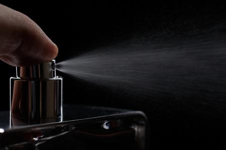 nozzle spray perume on black close up