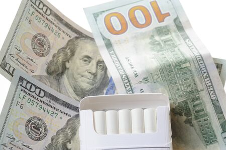 cigarette pack: open cigarette pack on top of dollar money isolated Stock Photo