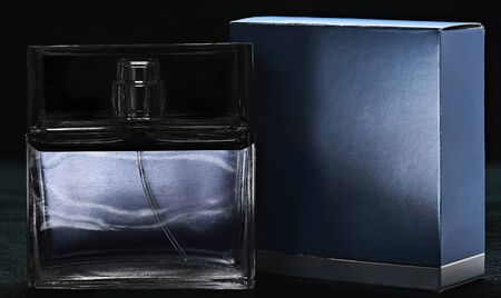 parfume: blue Parfume bottle and box isolated on black background