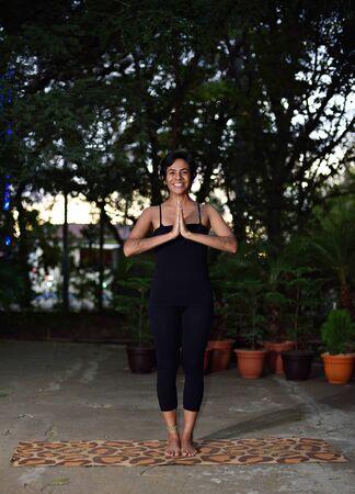yog: latino yog girl pose in morning garden