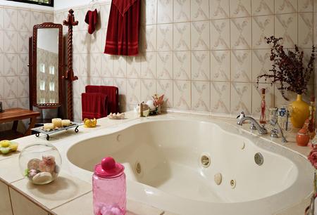 jacuzzi: home white empty  jacuzzi bath with accessories around