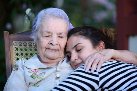 grandaughter: Grandma hugging her grandaugther