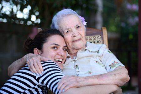 grandaughter: grandma and grandaughter smiling and hugging