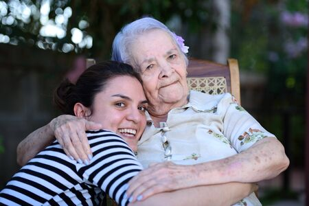 grandaughter: Grandma and grandaughter together hugging and laughing Stock Photo