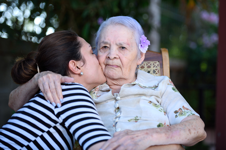 grandaughter: Grandaughter happy kissing her grandma Stock Photo