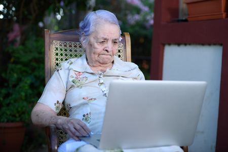 inteligent: Grandma concentrated and working on a laptop