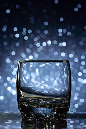 whisky glass: empty whisky glass on blue blurred background