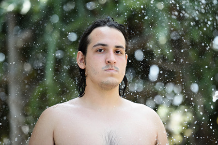 caucasian water drops: close up portrait man around water drops on blur background