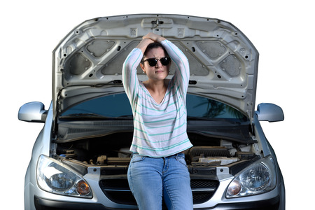 engine bonnet: upset sad girl with broken car waiting for help