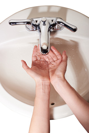 rinse: top view rinse hands with water in sink isolated Stock Photo