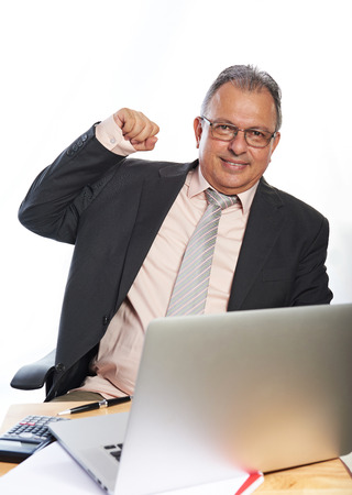 mature business man: business man  with glasses on working place isolated
