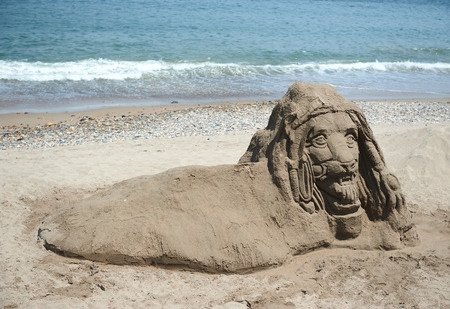 head in the sand: not finished sand statue with lion head