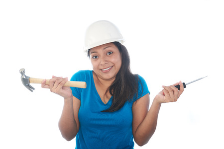 knowing: girl not knowing what to do with construction tools on a white background